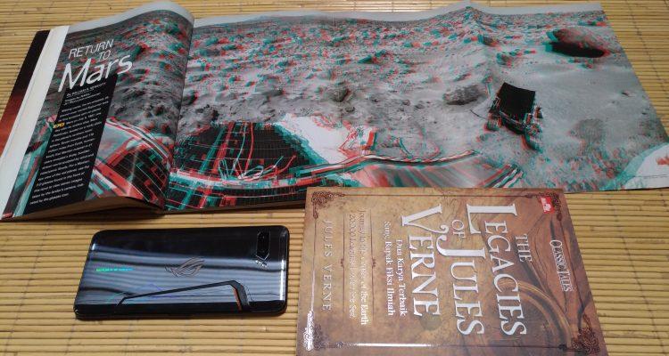 Buku fiksi jules verne, national geographoc dan ASUS ROG Phone 2